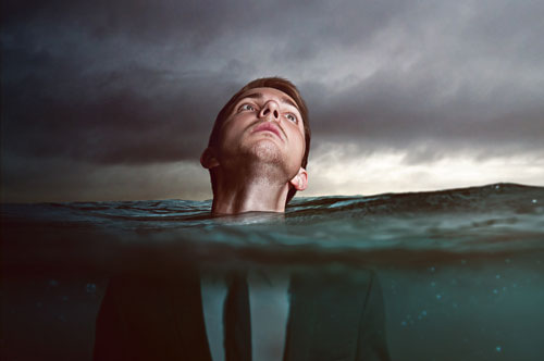 rising-waters-businessman.jpg